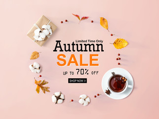 Wall Mural - Autumn sale banner with autumn leaves and cinnamon tea