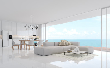 Luxury white living dining room with sea view 3d render.There is a minimalistic building interior with white fabric furniture. There is a large open sliding door overlooking the sea view.