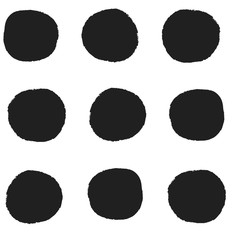 Seamless repeat pattern with big bold black irregular hand-drawn polka dots in rows on a white background