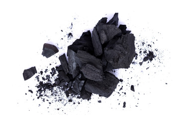 Pile of natural broken black activated charcoal granular and powder isolated on white background.