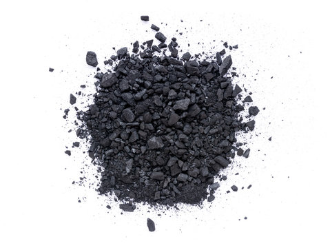 Pile of granular black activated charcoal  isolated on white background. Top view. Flat lay.