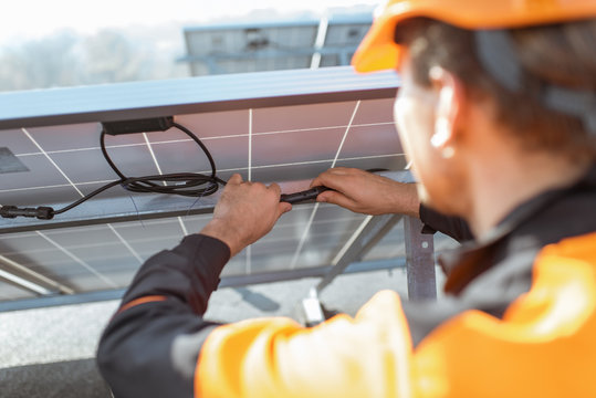 Electrician connecting solar panels