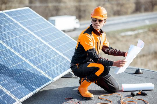 Electrician installing solar panels
