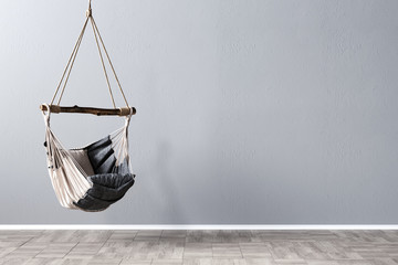 Swing chair in front of gray mockup wall, 3D Rendering, 3D Illustration