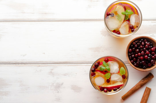 Spiced apple mocktail with mint and cinnamon. wooedn background