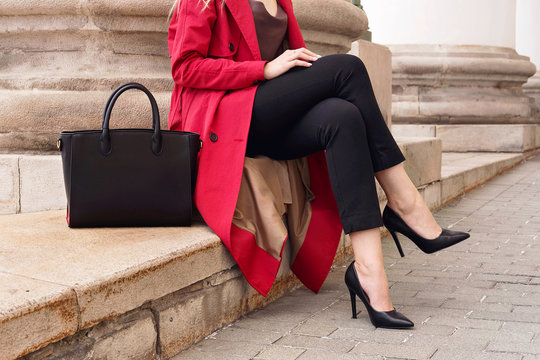 Fashion street portrait woman wear trendy red coat and bag