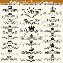 Illustration set of vintage calligraphic design elements with crowns.