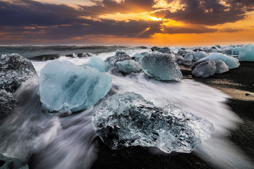 Ice rock with black sand beach at Jokulsarlon beach. Diamond beach in Iceland