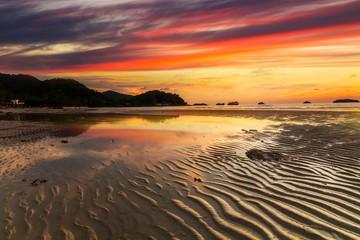 Beautiful sunset over the sandy beach on a tropical island. Thailand