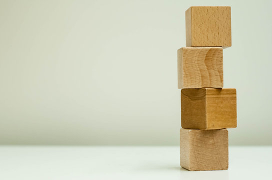 isolate. wooden cubes on white background. 4 cubes stacked in a pyramid
