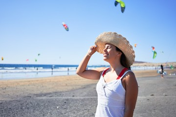 Young beautiful woman smiling happy enjoying summer vacation at the medano beach in Gran Canaria