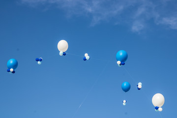 White and blue balloons flying in the sky, holiday celebration concept, congratulation with balloons - Image