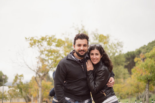 30-40 years old Couple in park posing for a photo