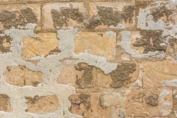 Background weathered Mediterranean stone wall