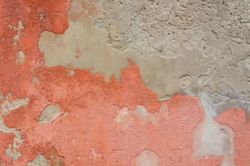 Background weathered red paint of concrete wall