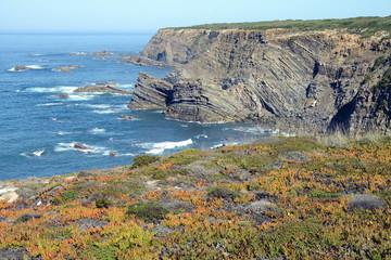 Dramatic and colorful cliffs on Alentejo West Coast at Cabo Sardao, Alentejo, Portugal