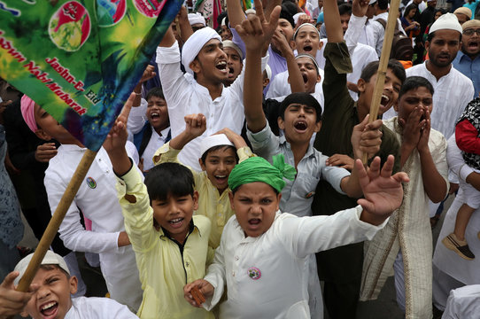Muslim children shout religious slogans during a religious procession to mark Eid-e-Milad-ul-Nabi, or birthday celebrations of Prophet Mohammad, in Kolkata