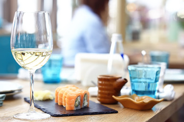 glass of white wine in the restaurant / white wine in the interior of the restaurant a table with glasses of wine, a romantic summer