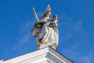 Statue with golden scepter and crown on St. Stephen's Cathedral (Dom St. Stephan) in Passau, Bavaria, Germany