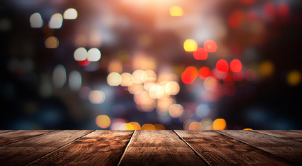 Wooden table, blurred bokeh background background. Neon light, night view, close-up. The general background of the interior, a dark background.