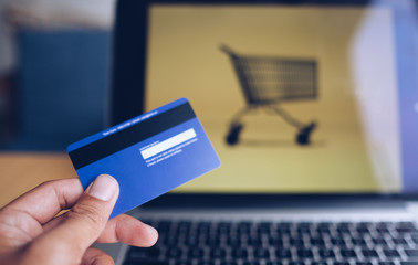 Comfort e-commerce shopping. Royalty high quality free stock photo image of shopping online and payment by credit card. Using laptop and mobile phone to online shopping and pay by visa credit card