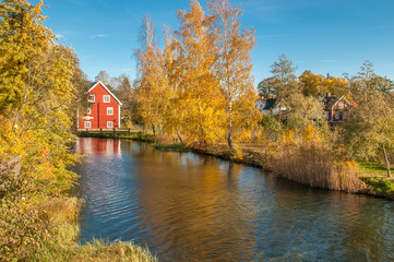 Traditional red house in the countryside of Ostergotland at Borensberg during autumn in Sweden