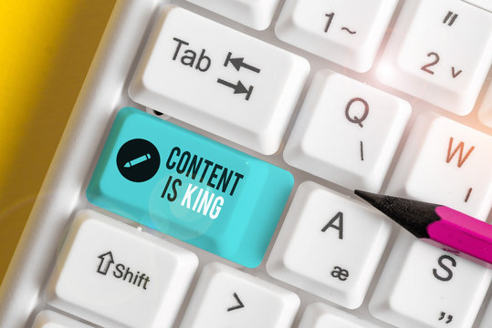 Text sign showing Content Is King. Business photo text believe that content is central to the success of a website White pc keyboard with empty note paper above white background key copy space