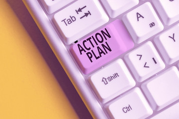 Text sign showing Action Plan. Business photo showcasing detailed plan outlining actions needed to reach goals or vision White pc keyboard with empty note paper above white background key copy space