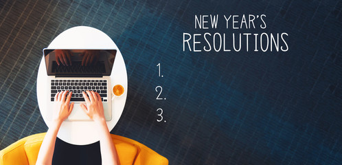New years resolution with person using a laptop on a white table