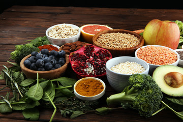 Canvas Prints Spices Healthy food clean eating selection: fruit, vegetable, seeds, superfood, cereals, leaf vegetable on rustic background