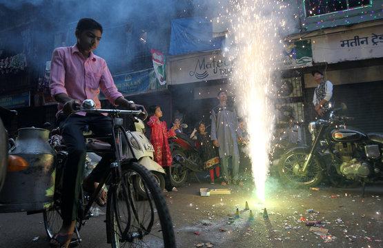 Muslim children light firecrackers during a celebration to mark Eid-e-Milad-ul-Nabi, or birthday celebrations of Prophet Mohammad, in Mumbai