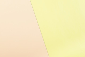 Color paper  background. Two pastel tone - pink and yellow