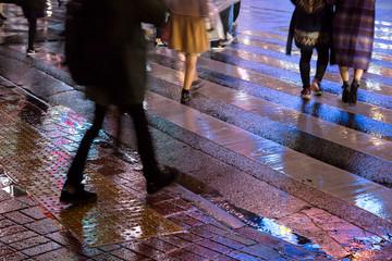 Legs of people crossing street at rainy night, Tokyo, Japan 雨の夜の渋谷スクランブル交差点を渡る人々 脚