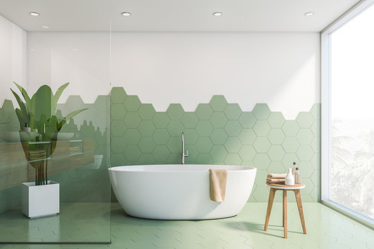 Green and white tile bathroom interior, tub