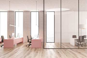Open space office, pink tables and meeting room