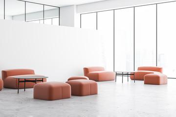 White office lounge with orange sofas