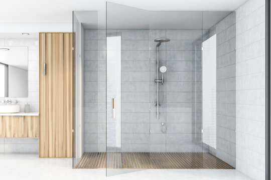 White tile bathroom interior with shower
