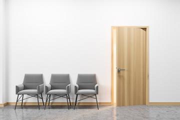 Row of armchairs near door
