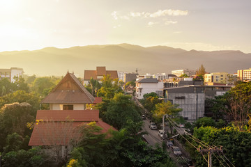 Chiang Mai cityscape with a Doi Suthep mountain at background at sunset, Thailand
