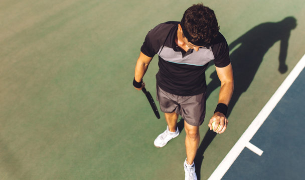 Player about to serve in a tennis game