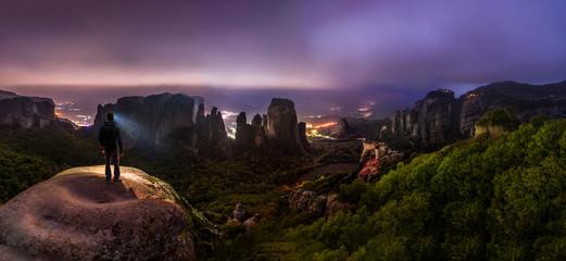 Night Hike in Greek Meteora mountains - overlooking castle-like monasteries