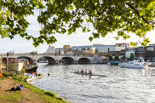 Kingston Upon Thames with the river Thames being used by rowers and motor boats