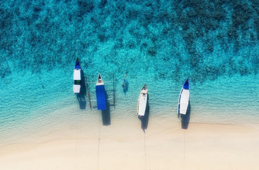 Boats on the water surface from top view. Azure water background from top view. Summer seascape from air. Travel - image