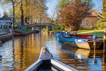 Peaceful landscape boating a beautiful Dutch canal,  Giethoorn, Netherlands