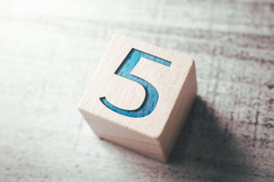 Number 5 On A Wooden Block On A Table