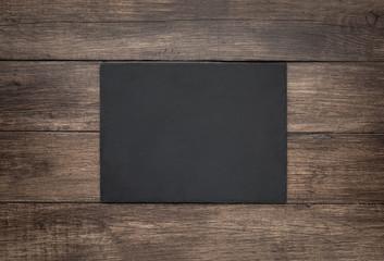 Fototapete - Blank slate board on wooden background