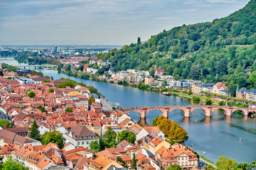 Heidelberg town with old Karl Theodor bridge and castle on Neckar river in Baden-Wurttemberg, Germany