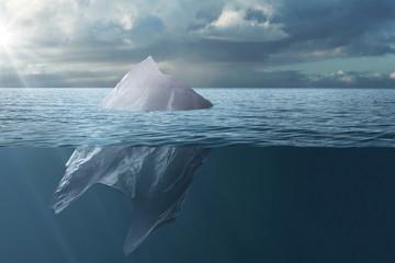 Plastic bag floating in the sea like an iceberg