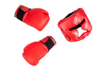 Boxing helmet and boxing gloves isolated on white. The concept of sport and active leisure....