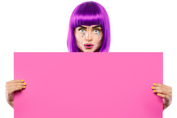 Model in creative image with pop art makeup is holding pink blank board